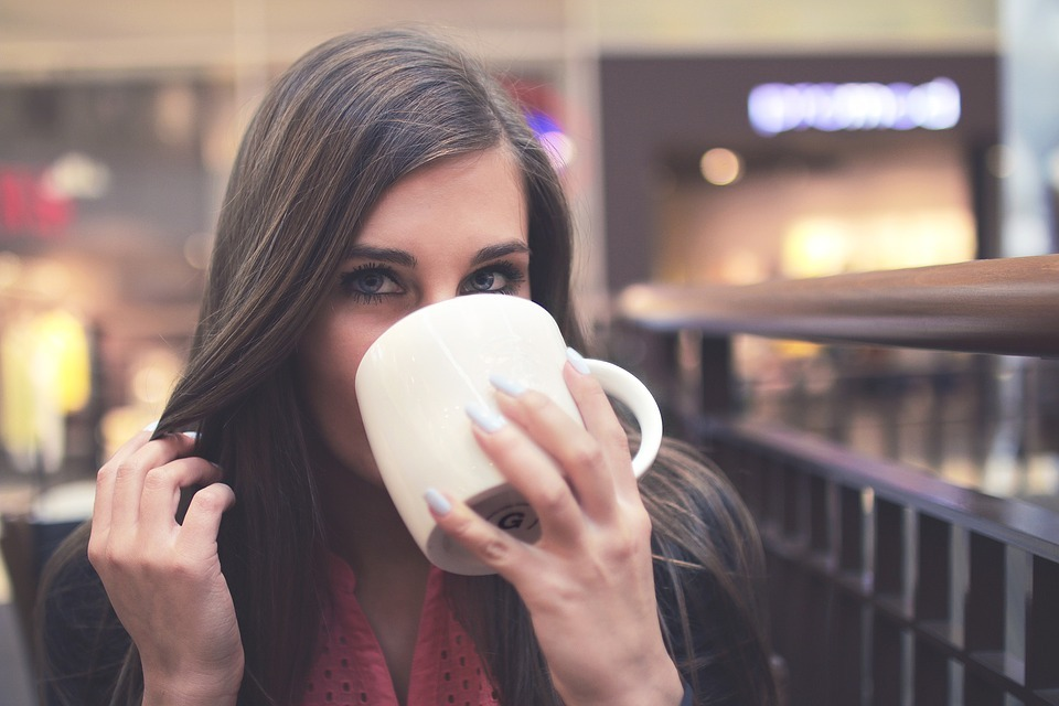 woman-drinking-coffee Tips for dealing with sensitive teeth from your local by Dr. Michael Boisson at Boisson Dental Group in Grande Prairie, Alberta